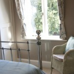 Chair by bedroom window